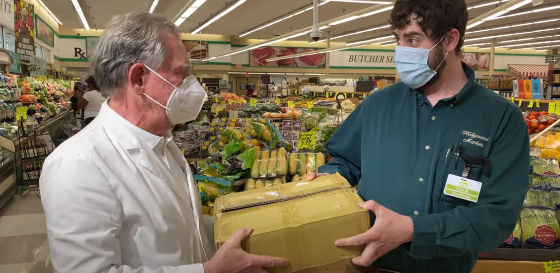 Sandy Munro gives out masks to grocery stores